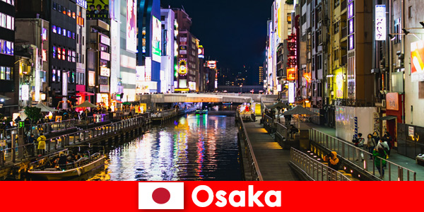 Dzielnice rozrywki i przysmaki czekają na zagranicznych podróżnych w Osace w Japonii